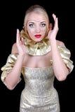 Mulher atrativa no vestido venetian dourado imagem de stock royalty free