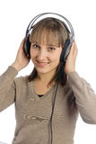 Mulher atrativa nova com fones de ouvido Fotografia de Stock Royalty Free