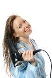 Mulher atrativa nova com hairdryer Imagem de Stock Royalty Free