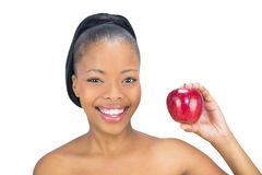 Mulher atrativa que guardara a maçã vermelha Fotos de Stock Royalty Free