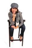 Mulher atrativa que senta-se na cadeira fotos de stock