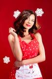 Mulher atrativa sobre o fundo do Natal Fotografia de Stock Royalty Free