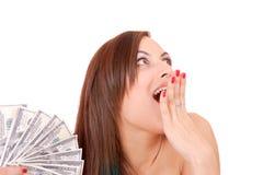 A mulher atrativa toma um lote de 100 contas de dólar Imagens de Stock