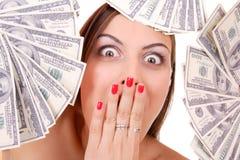 A mulher atrativa toma um lote de 100 contas de dólar Fotografia de Stock Royalty Free