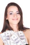 A mulher atrativa toma um lote de 100 contas de dólar Foto de Stock Royalty Free