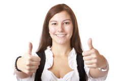 Mulher bávara com o dirndl que mostra os polegares acima. Fotografia de Stock