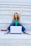 Mulher bem sucedida com portátil Imagem de Stock Royalty Free