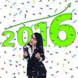 Mulher bem sucedida feliz com números 2016 Fotos de Stock Royalty Free