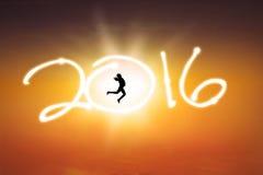 Mulher bem sucedida que salta com números 2016 Imagens de Stock Royalty Free