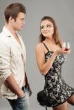 A mulher bonita bebe o vinho e o homem foto de stock royalty free