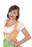 A mulher bonita, bávara no Dirndl sorri feliz Imagens de Stock Royalty Free