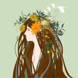 Mulher bonita com as flores no cabelo Imagens de Stock Royalty Free