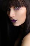 Mulher bonita com composição violeta Imagens de Stock Royalty Free