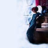Mulher bonita com a flor no cabelo Foto de Stock Royalty Free