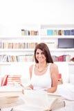 Mulher bonita com livros imagens de stock royalty free