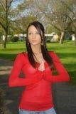 Mulher bonita com a mão dobrada imagens de stock royalty free