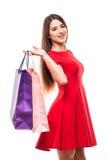 Mulher bonita com os sacos shoping da cor nas mãos no fundo branco Imagens de Stock Royalty Free
