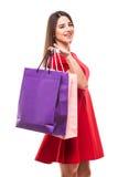 Mulher bonita com os sacos shoping da cor nas mãos no fundo branco Foto de Stock