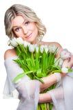 Mulher bonita com os tulips no branco isolado Fotografia de Stock Royalty Free