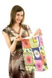 Mulher bonita com sacos de compra; isolado no branco Fotografia de Stock Royalty Free