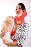 Mulher bonita com um cão de filhote de cachorro foto de stock royalty free