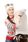 Mulher bonita com um snowboard no estúdio Foto de Stock Royalty Free