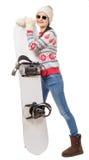 Mulher bonita com um snowboard no estúdio Imagem de Stock