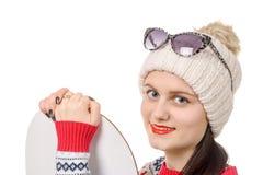 Mulher bonita com um snowboard no estúdio Fotografia de Stock