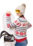 Mulher bonita com um snowboard no estúdio imagens de stock royalty free