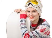 Mulher bonita com um snowboard no estúdio foto de stock