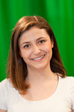 Mulher bonita com um sorriso delicioso Foto de Stock Royalty Free
