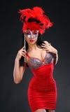 Mulher bonita com uma máscara foto de stock royalty free