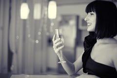 Mulher bonita com vidro do champanhe Fotografia de Stock Royalty Free