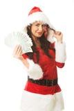 Mulher bonita de Santa que guarda um grampo da mecha polonesa do dinheiro e do cabelo Imagens de Stock