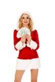 Mulher bonita de Santa que guarda um grampo do dinheiro polonês Foto de Stock Royalty Free