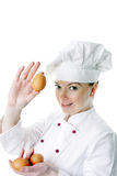 Mulher bonita do cozinheiro com ovo Imagem de Stock