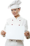 Mulher bonita do cozinheiro que prende uma placa de observação imagens de stock