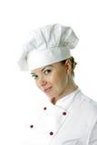 Mulher bonita a do cozinheiro sobre o fundo branco Fotografia de Stock Royalty Free