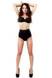 Mulher bonita e 'sexy' que desgasta a roupa interior preta Fotografia de Stock Royalty Free