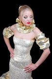 Mulher bonita em dourado foto de stock