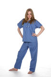 A mulher bonita em médico azul esfrega Imagens de Stock Royalty Free