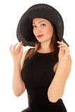 Mulher bonita em pouco vestido preto isolado no branco imagem de stock royalty free