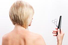 A mulher bonita em seu cabelo seca Imagens de Stock Royalty Free