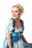 Mulher bonita em um dirndl bávaro tradicional Fotos de Stock Royalty Free