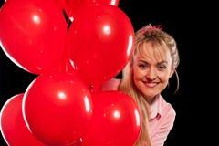 Mulher bonita na blusa com balões vermelhos Fotografia de Stock Royalty Free
