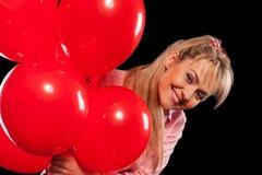 Mulher bonita na blusa com balões vermelhos Foto de Stock Royalty Free