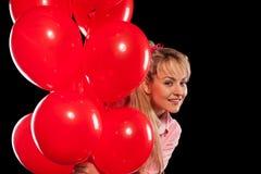 Mulher bonita na blusa com balões vermelhos Imagem de Stock