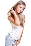 Mulher bonita no calças de brim com Tag de cão Imagem de Stock Royalty Free