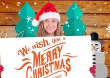 Mulher bonita no chapéu de Santa que guarda o cartaz 3D Imagens de Stock Royalty Free