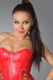 Mulher bonita no espartilho vermelho Imagens de Stock Royalty Free
